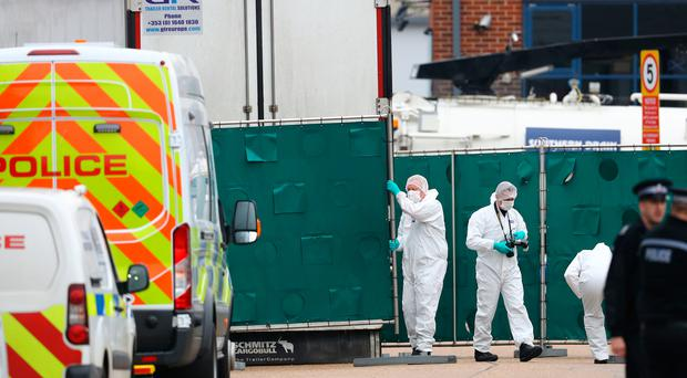 Police forensics officers at the lorry where the bodies were found