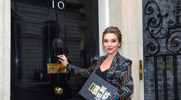 Publican Candice Brown delivers a petition to 10 Downing Street calling for a cut in beer duty (Matt Crossick/PA)