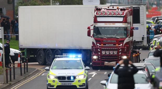 The container lorry where 39 people were found dead inside leaves Waterglade Industrial Park in Grays, Essex (Aaron Chown/PA)