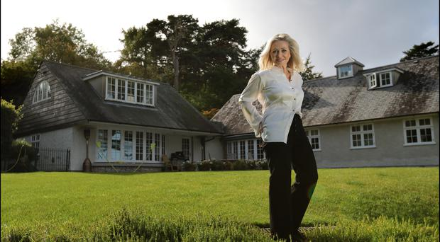 Author Cathy Kelly outside her arts and crafts-style dormer bungalow in Wicklow