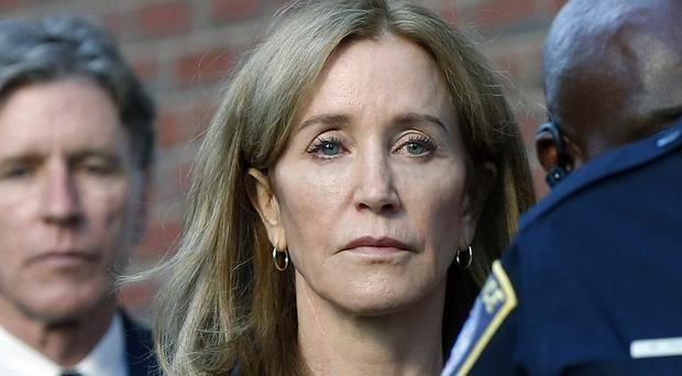 Felicity Huffman was sentenced to 14 days in federal prison (Michael Dwyer/AP)