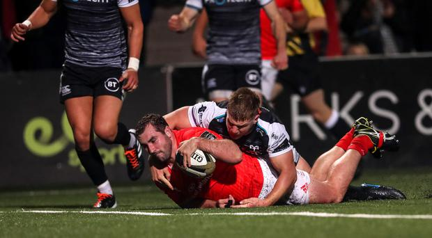 Touch down: Munster's James Cronin scores a try last night