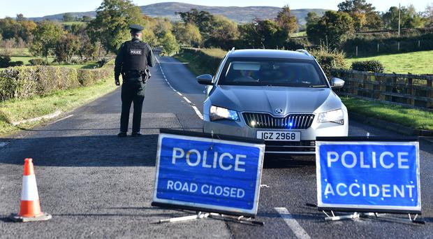 Police at the scene after an 18-year-old man died following a single vehicle car crash on the Hilltown Road in Kilcoo, County Down. Photo Colm Lenaghan/Pacemaker Press