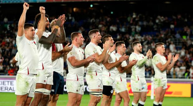 England celebrate their stunning 19-7 World Cup win over New Zealand.