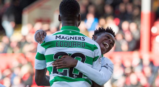 Celtic's Jeremie Frimpong celebrates with Celtic's Odsonne Edouard after scoring the second goal during the Ladbrokes Scottish Premiership match at Pittodrie Stadium, Aberdeen. Photo credit: Ian Rutherford/PA Wire.