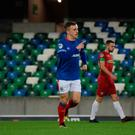 In front: Linfield's Joel Cooper after his winner last night
