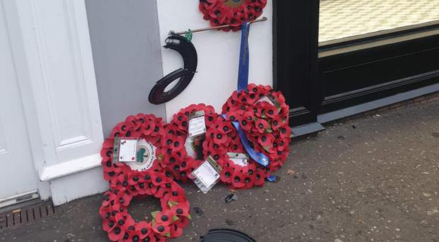The damage to the wreaths at the memorial