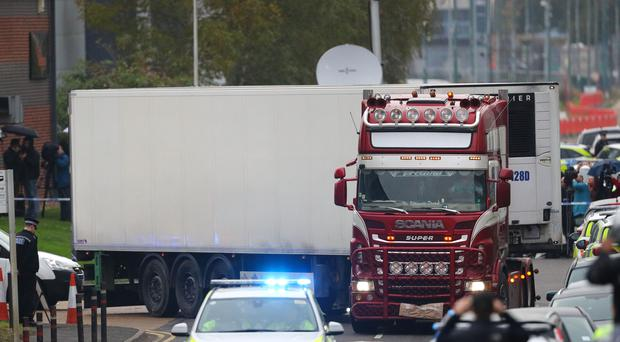 The container lorry where 39 people were found dead inside leaves Waterglade Industrial Park in Grays, Essex, heading towards Tilbury Docks under police escort (Aaron Chown/PA)