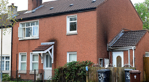 Detectives are investigating an arson attack at this house in Aitnamona Crescent in west Belfast