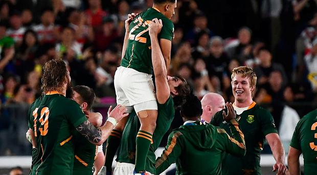 South Africa's players celebrate winning the Japan 2019 Rugby World Cup final match. Credit: Charly Triballeau/AFP