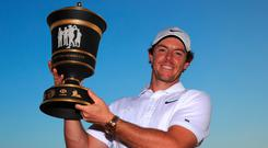 Rory McIlroy gets his hands on the trophy after a thrilling win at Sheshan International Golf Club