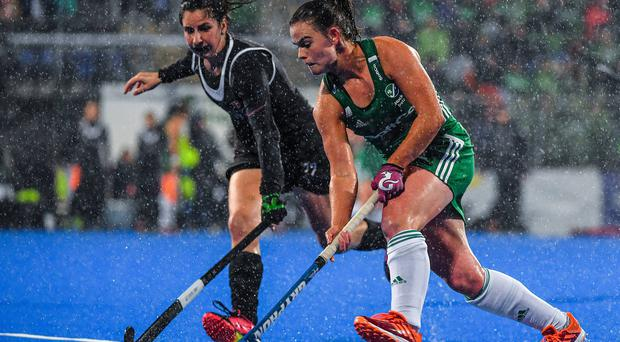 Lizzie Colvin of Ireland in action against Madeline Secco of Canada during the FIH Women's Olympic Qualifier match between Ireland and Canada at Energia Park in Dublin. Credit: Brendan Moran/Sportsfile