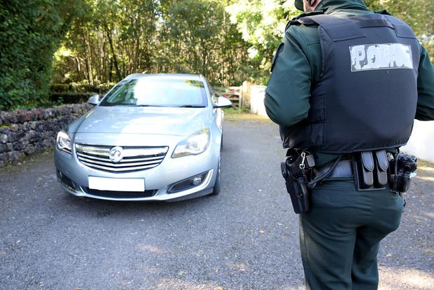 PSNI at the scene of Kevin Lunney's abduction near Kinawley Co Fermanagh. Credit: Press Eye
