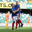 Linfield's Shayne Lavery celebrates with Joel Cooper after scoring the opening goal against Glenavon. Credit: INPHO/Brian Little