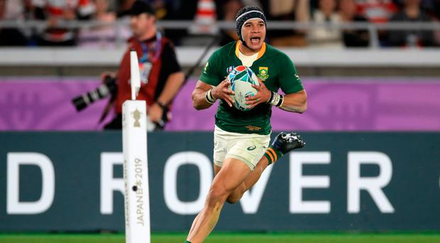 Winning ways: South Africa's Cheslin Kolbe scores his side's second try in the final