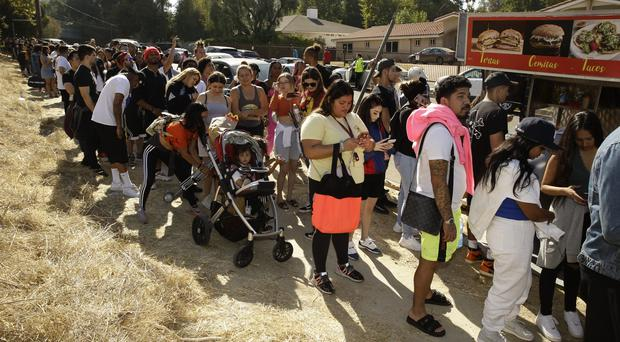 People line up near Chris Brown's home (Damian Dovarganes/AP)