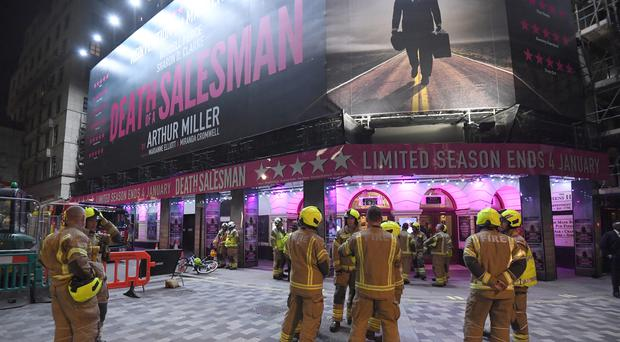 Firefighters outside the Piccadilly Theatre, London, following its evacuation on Wednesday (Kirsty O'Connor/PA)