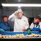 Prime Minister Boris Johnson during a visit to Tayto Castle crisp factory in Tandragee. Credit: Stefan Rousseau/PA Wire