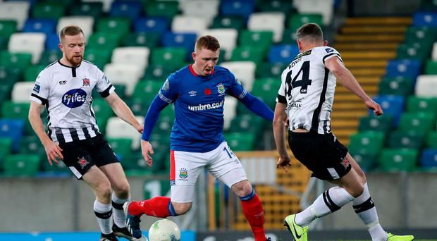 In control: Shayne Lavery takes on Dundalk