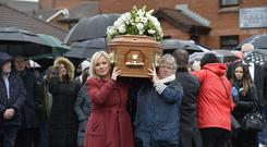 Mourners and friends pictured at the Funeral for Father Des Wilson who passed away on Tuesday. Credit Presseye/Stephen Hamilton