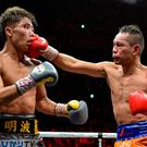 Naoya Inoue of Japan (L) and Nonito Donaire of Philippines (R) fight in their World Boxing Super Series bantamweight final. (Photo by Kazuhiro NOGI / AFP) (Photo by KAZUHIRO NOGI/AFP via Getty Images)