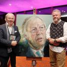 Eamonn Mallie launches his book of poems at the Lyric Theatre with Colin Davidson who provided the picture for the book cover