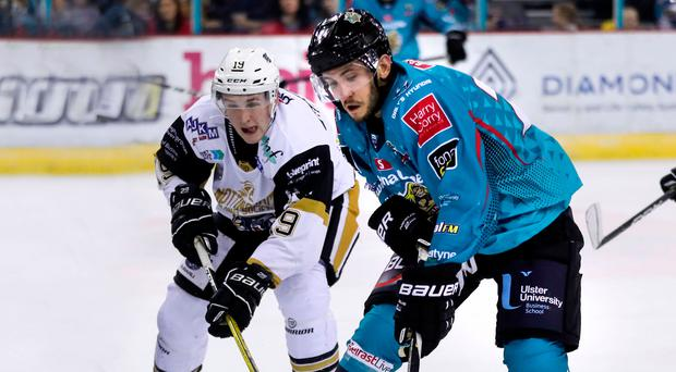 Stuck in: Belfast Giants ace Brian Ward in action