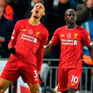 Fab strike: Fabinho celebrates his Liverpool wonder goal with Mane