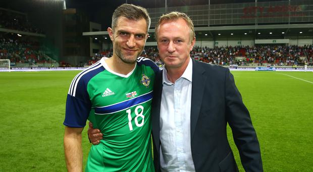 Great times: Aaron Hughes on night of his 100th cap with Michael O'Neill
