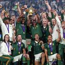 Cyril Ramaphosa, President of South Africa lifts the Webb Ellis Cup. The tournament helped ITV grow revenues in the third quarter of the year (PA)