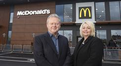 Fast food giant McDonald's has created 65 jobs in east Belfast with the opening of the first two-storey, dual lane drive thru restaurant in Northern Ireland - pictured are McDonalds franchisee Des Lamph and Director of Franchising and Operations Sarah Carter