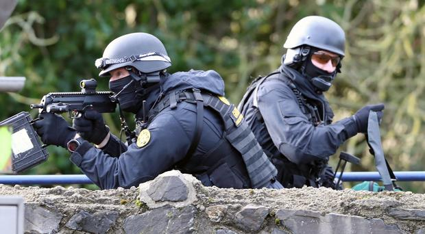 Members of the Garda Emergency Response unit during a multi-agency emergency exercise at the Newtownfane Pumping station in Co Louth (Niall Carson/PA)