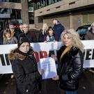Deborah Cassidy and Danielle O'Neill, patients of Dr Watt hand in a letter to Richard Pengelly at Stormont Castle Buildings on November 12th 2019 (Photo by Kevin Scott for Belfast Telegraph)