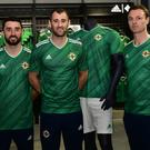 Northern Ireland's Connor McLaughlin, Niall McGinn and Jonny Evans modelling the new home jersey at Windsor Park (Colm Lenaghan/Pacemaker Press)