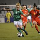 Northern Ireland's Rachel Furness in action with Wales' Angharad James. Credit Presseye/Stephen Hamilton