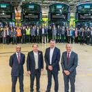 Buta Atwal, chief executive at Wrightbus; Jo Bamford, executive chairman at Wrightbus; Jon Harman, head of fleet at First Group UK Bus and John McLeister, sales and business development director at Wrightbus with staff and the new vehicles.