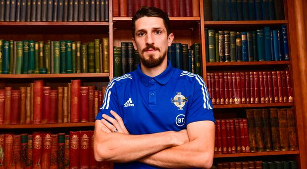 Booked up: Craig Cathcart wants Michael O'Neill to see the job through with Northern Ireland