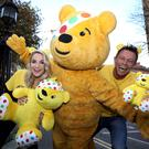BBC Children in Need are presenters Holly Hamilton and Stephen Clements with Pudsey Bear.