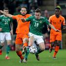 Northern Ireland's Gavin Whyte with Netherlands' Daley Blind during Saturday nights UEFA Euro 2020 Qualifier at the National Stadium, Belfast.