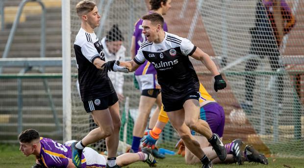 Net gains: Kilcoo's Aaron Branagan celebrates scoring the only goal in his side's victory over Derrygonnelly