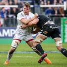Gripping stuff: Ulster ace Jordi Murphy comes under attention from Bath's Charlie Ewels