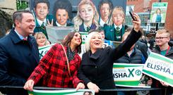 Michelle O'Neill, Elisha McCallion and John Finucane lark around in front of a Derry Girls mural at the weekend