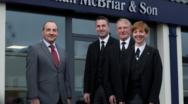 Derick Wilson, business development manager at Ulster Bank, with Norman McBriar and siblings Mark McBriar and Donna Spiers