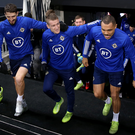 Big stage: Steven Davis leads out Craig Cathcart and Josh Magennis, who win their 50th caps tonight, at training in Frankfurt last night