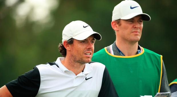 Rory McIlroy looks on with temporary caddie Niall O'Connor during practice prior to the DP World Tour Championship (Ross Kinnaird/Getty Images)