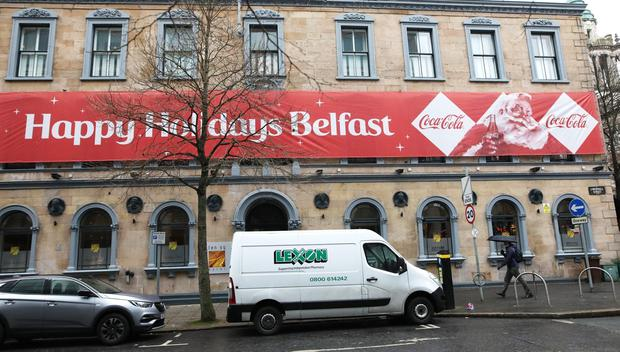 Ten Square hotel in Belfast City centre with the Banner on the listed building wishing people a happy Christmas, Belfast city council have asked it to be removed. Photo by Peter Morrison