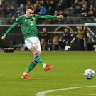 Northern Ireland's Michael Smith scores against Germany in Frankfurt (Colm Lenaghan/Pacemaker Press)