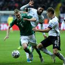 Northern Ireland's George Saville battles with Germany duo Joshua Kimmich (right) and Emre Can (back) during Tuesday night's Euro 2020 qualifier in Frankfurt (William Cherry/Presseye)