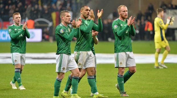 Northern Ireland's Steve Davis and Josh Magennis after Tuesday's game in Frankfurt. Credit: Colm Lenaghan / Pacemaker Press