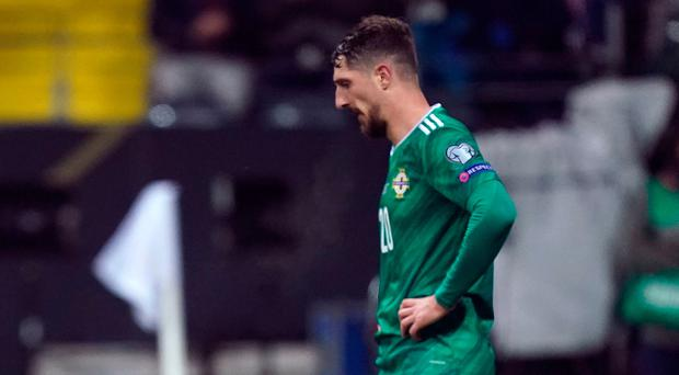 Dejection: defender Craig Cathcart and keeper Bailey Peacock-Farrell are floored by Germany last night